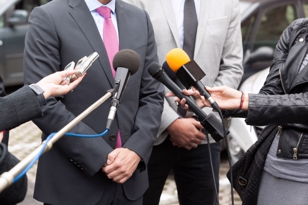 Lawyer speaking to reporters outside of a courtroom