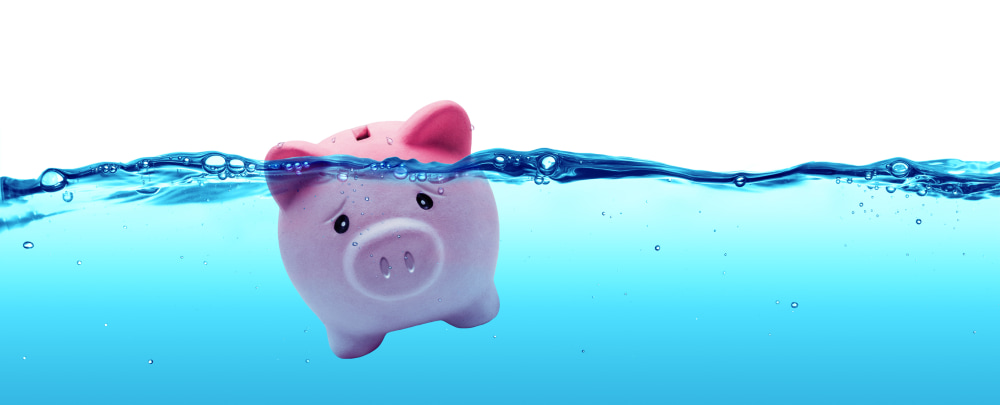 Piggy bank drowning in water