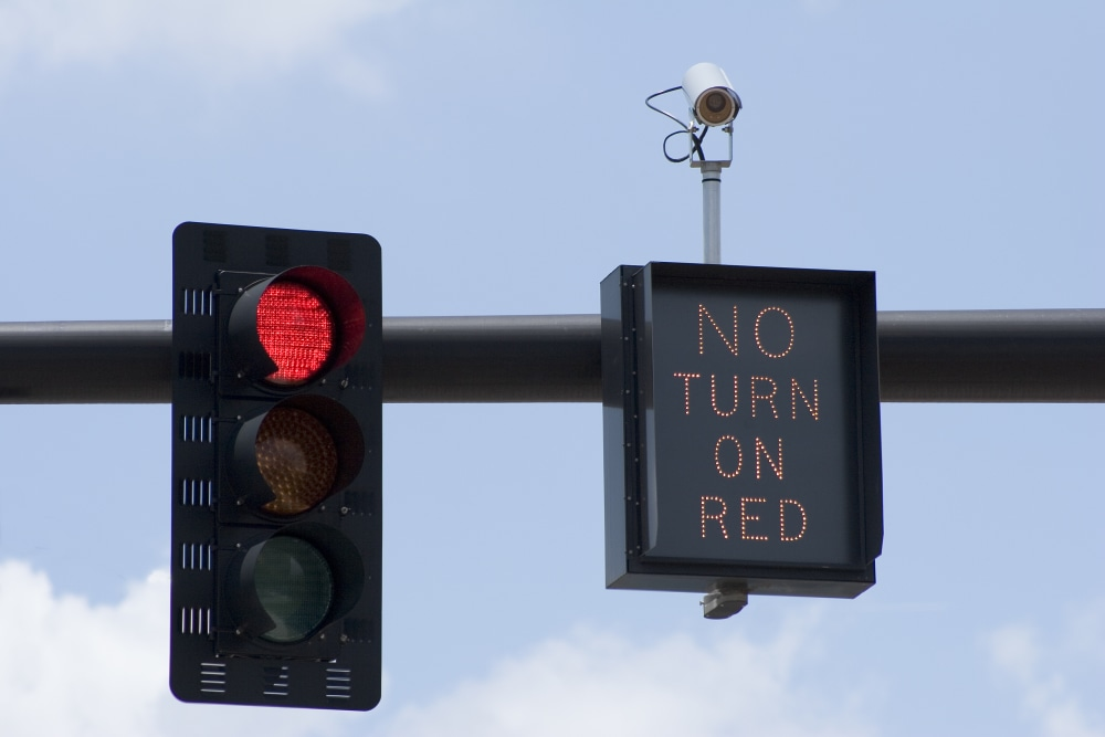 red traffic light next to no turn on red sign