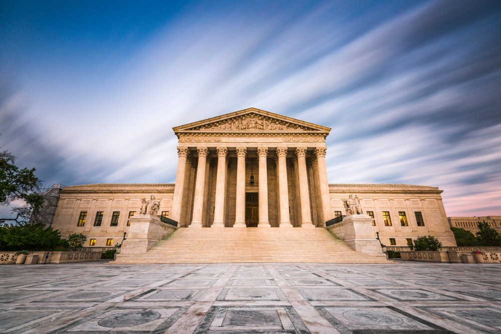 The U.S. Supreme Court building under a blue sky
