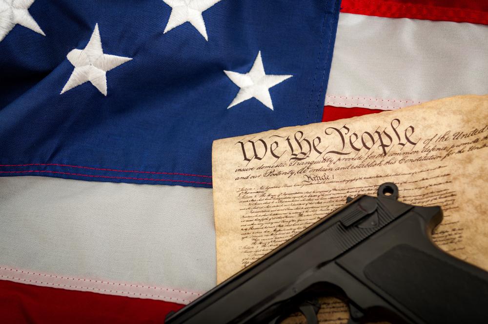 U.S. Flag, U.S. Constitution and a handgun