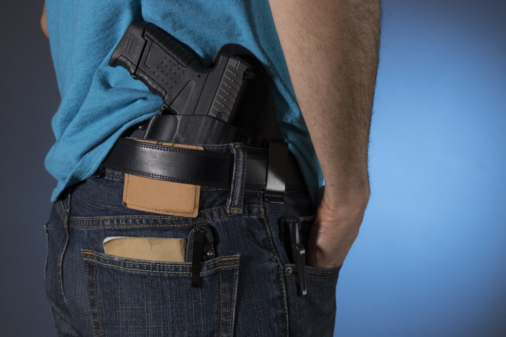 Man with a handgun in his back pocket