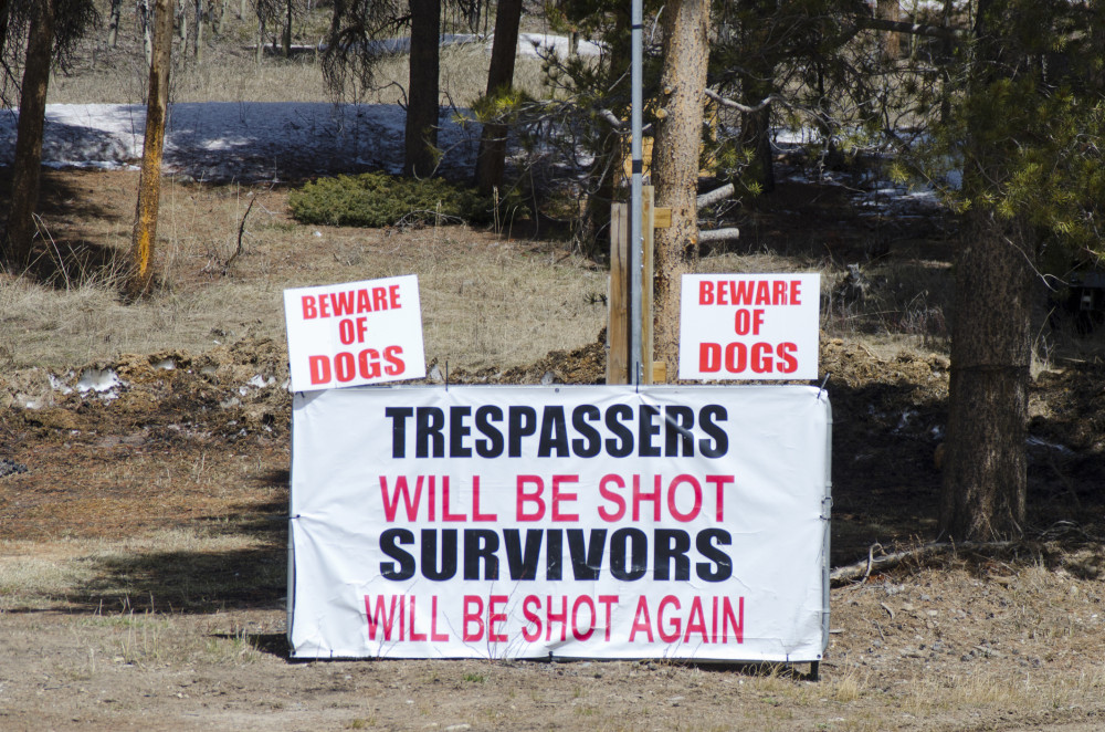 A land owner lets trespassers know what will happen to them if they wander onto his property.  There is plenty of copy space available for your own message.