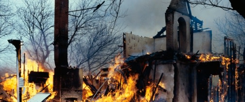 Abandoned house fully engulfed in flames