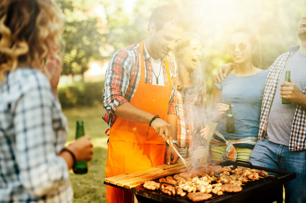 Young people enjoying barbecuing before COVID-19 restrictions.