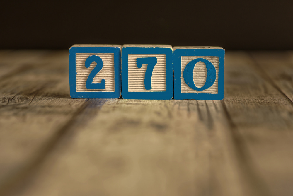 Wood blocks in blue with 270 on them to represent the number of Electoral College votes needed to win the US presidential election
