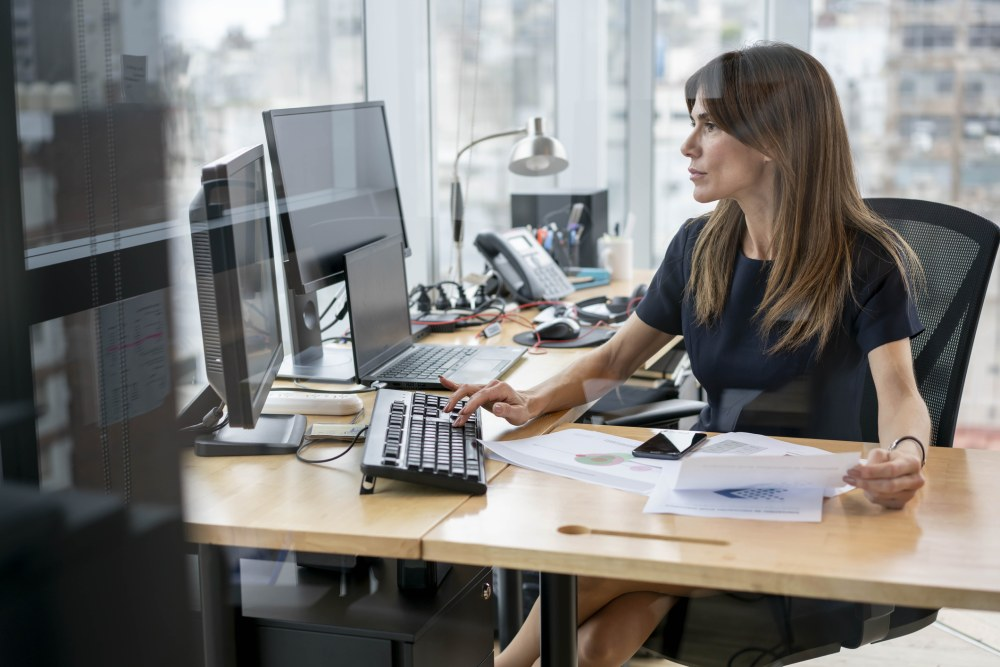 Lawyer working in office with desktop and laptop