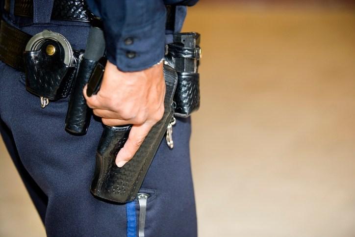 Policeman's hand on gun