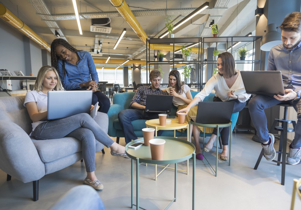 Young people making strategy for startup business in casual co working space