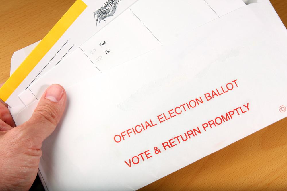 Man open ballot he got in the mail