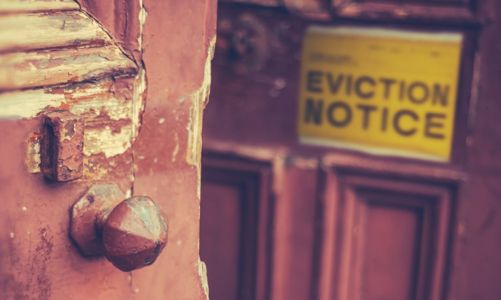 Grungy Old Door With A Yellow Eviction Notice