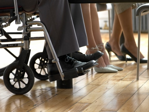 Low Section of Business Men and Women, Man Sitting in a Wheelchair