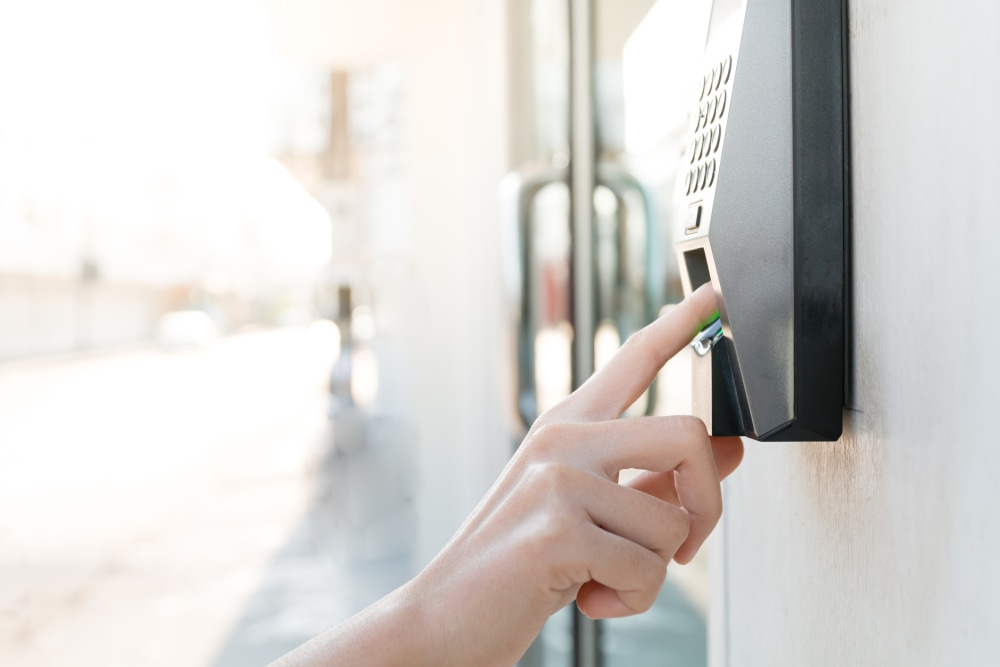 Woman using fingerprint scanner outside of an office building