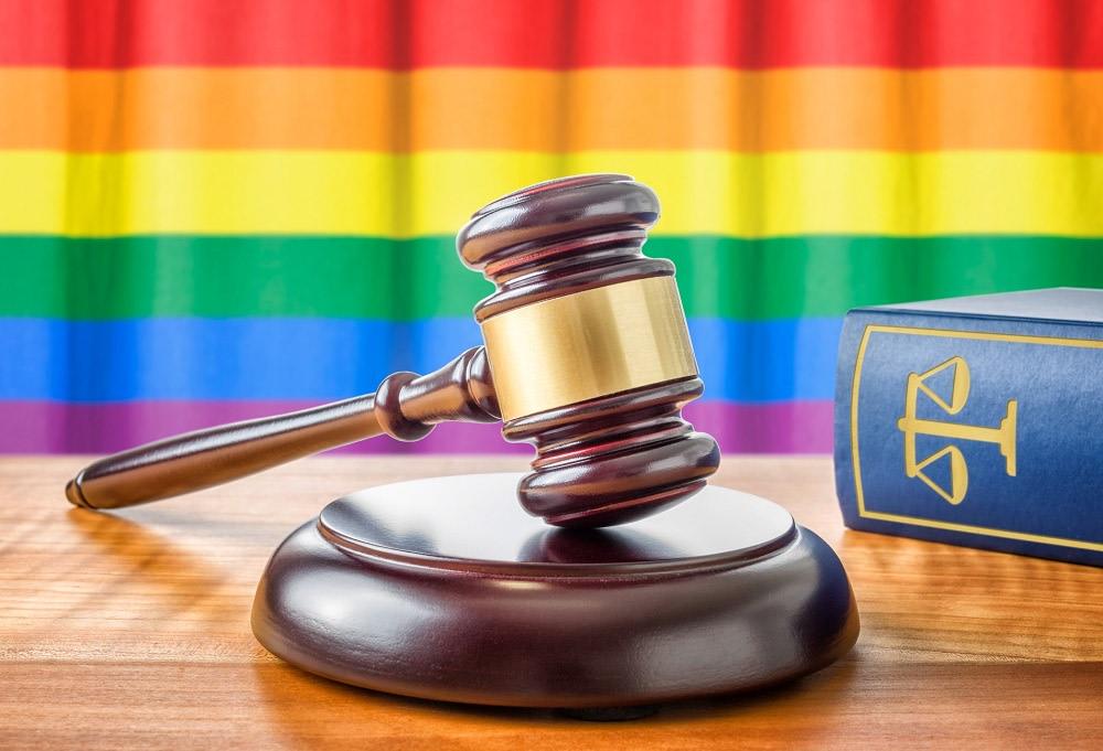 A gavel and a law book - Rainbow flag