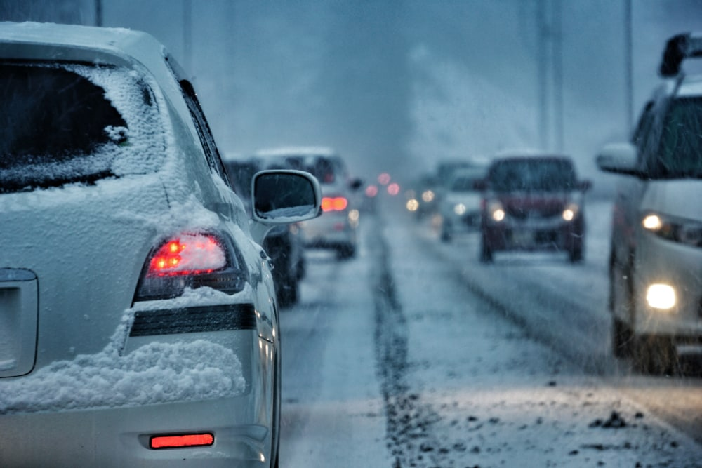 Cars driving on icy, snowy road