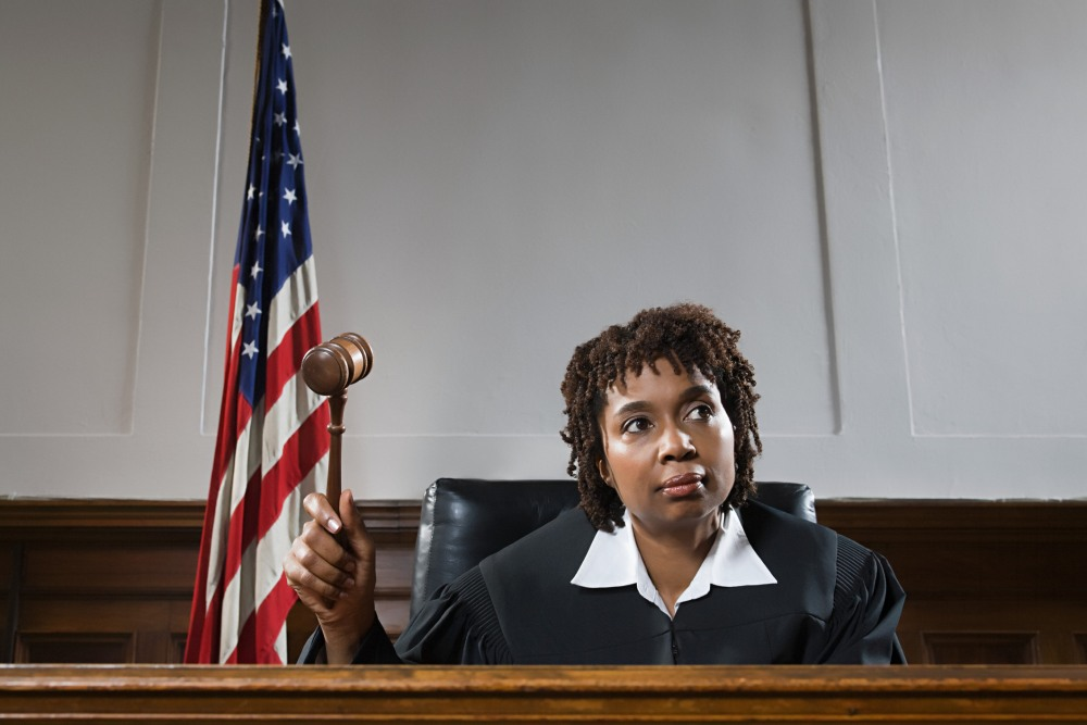 Judge in court holding a gavel
