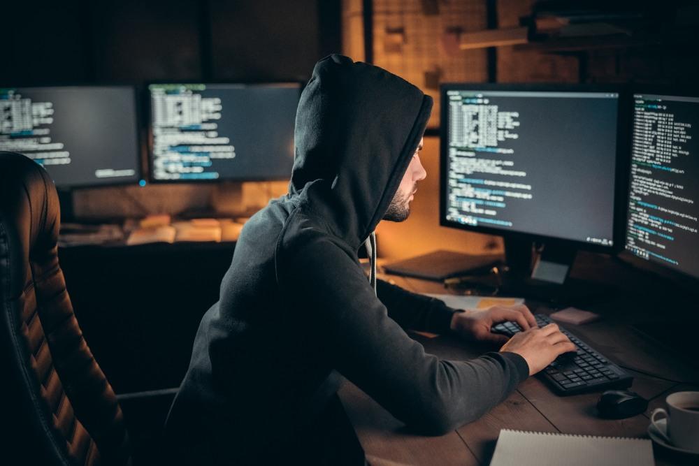 Online terrorist send virus at big company. Indoor, studio shot. Hacker attack, virus, net security concept