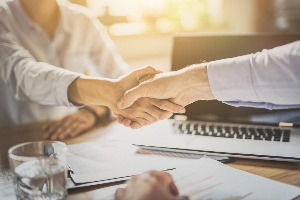 Handshake over a desk