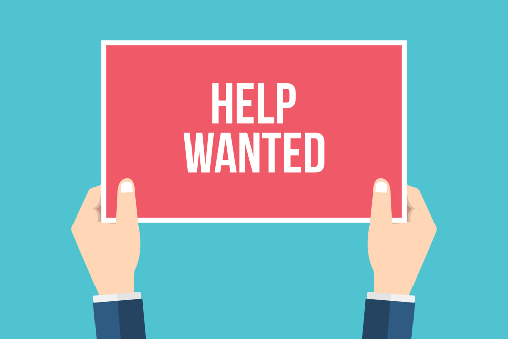 Help wanted. Hands holding placard, sign. Flat style vector illustration