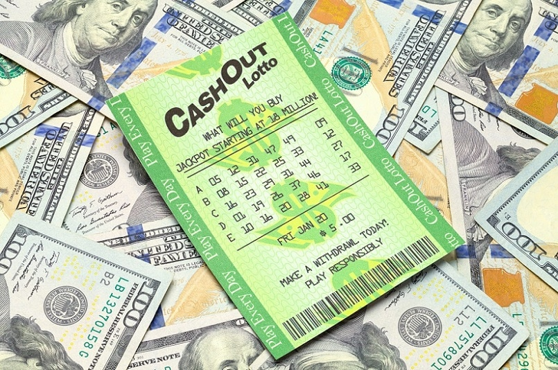 Lottery ticket on a pile of money