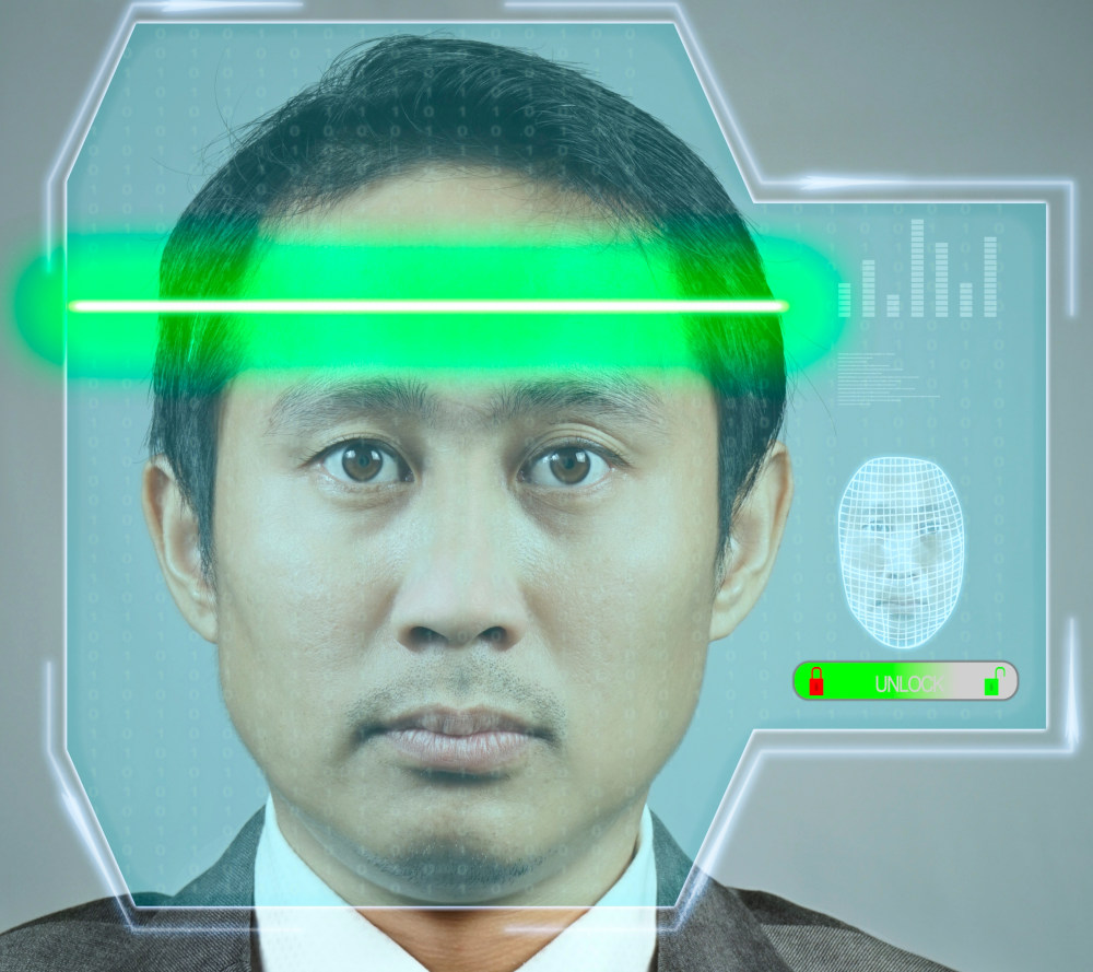 Businessman getting face scanned