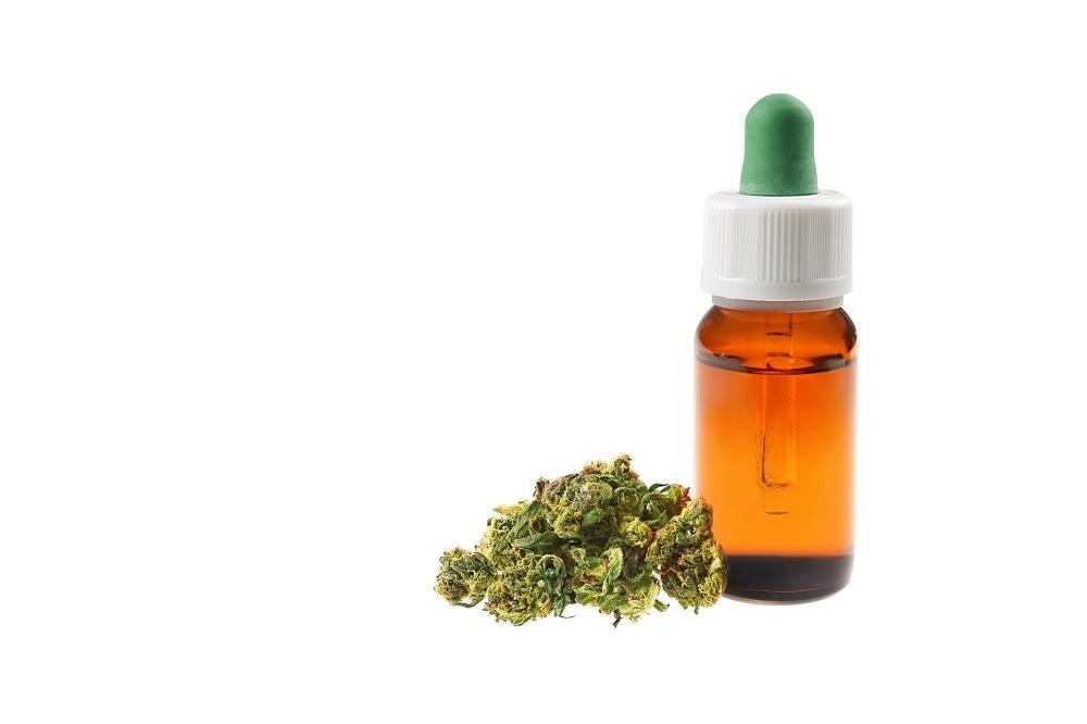 Marijuana oil cbd bottle isolated on white background
