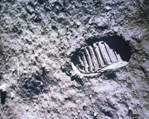 a footprint on the surface of the moon