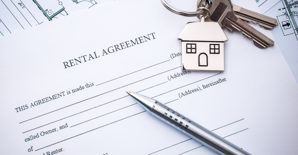 Picture of rental agreement with pen and housekeys