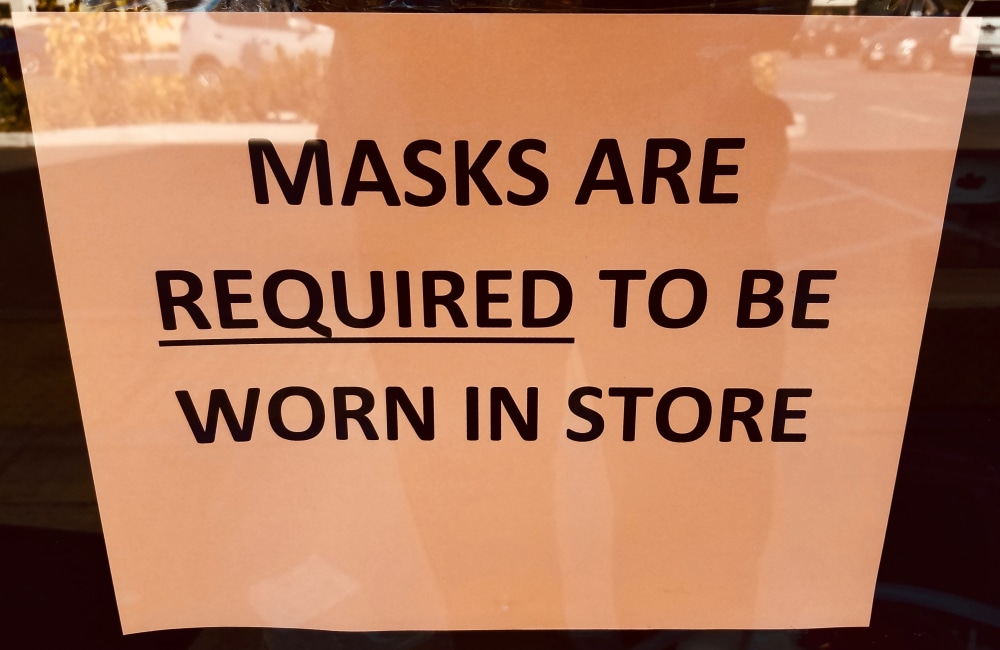 store-sign-saying-masks-required