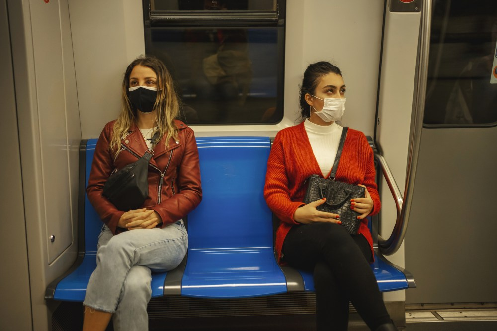 two women travel by subway