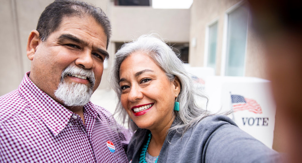A Mexican-American couple take a selfie after casting their vote