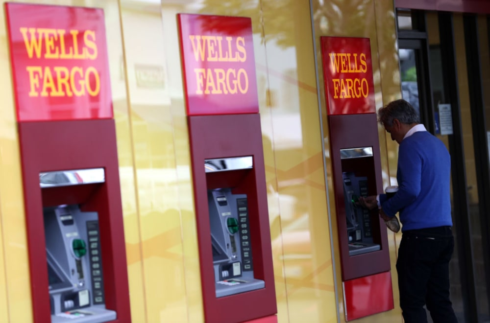 SAN FRANCISCO, CALIFORNIA - FEBRUARY 07: A customer uses an ATM at a Wells Fargo Bank office on February 07, 2019 in San Francisco, California. Wells Fargo customers are experiencing difficulty using ATMs and the Wells Fargo phone app after reports of a technical issue at the outage at a server farm located in Shoreview, Minnesota. (Photo by Justin Sullivan/Getty Images)