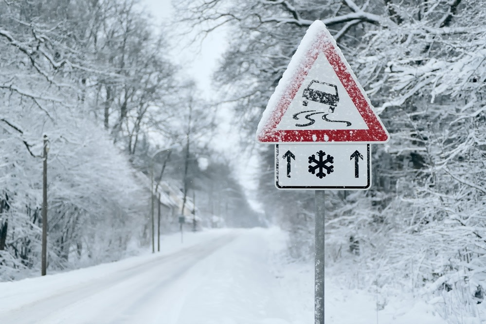 Heavy snowfall on a country road. Driving on it becomes dangerous � �