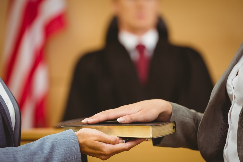 Witness swearing on the bible telling the truth in the court room or pleading no contest