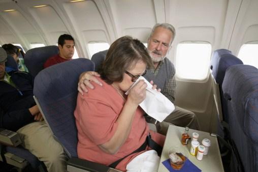 Woman sick on an airplane.
