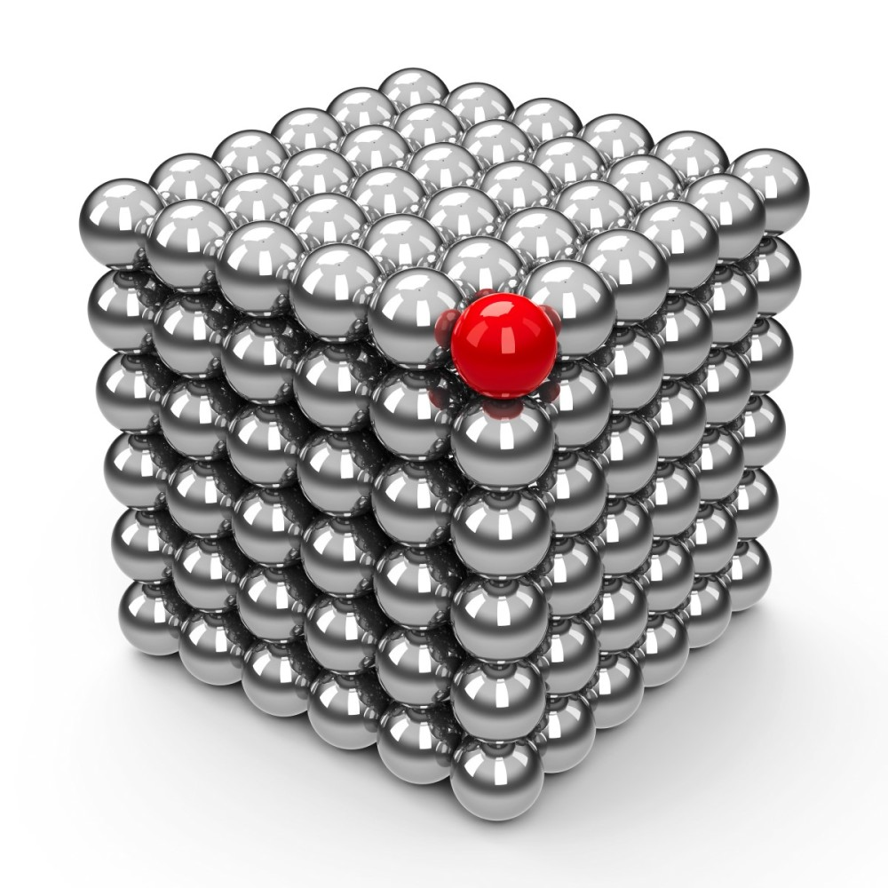 a cube formed by magnetic silver balls, with the top corner colored red